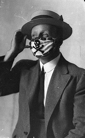 Flickr Photo Download: Compulsory mask, brought in to combat the flu epidemic after the World War, 1918-1919   Sam Hood