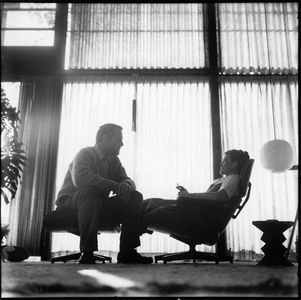 B , Charles, right, and Ray Eames sitting on their...