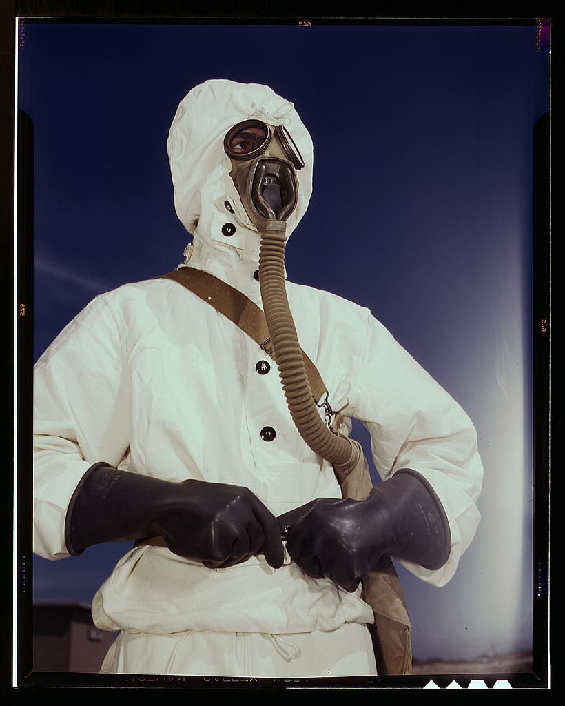 Flickr Photo Download: Sailor at the Naval Air Base wears the new type protective clothing and gas mask designed for use in chemical warfare, Corpus Christi, Texas. These uniforms are lighter than the old type (LOC)