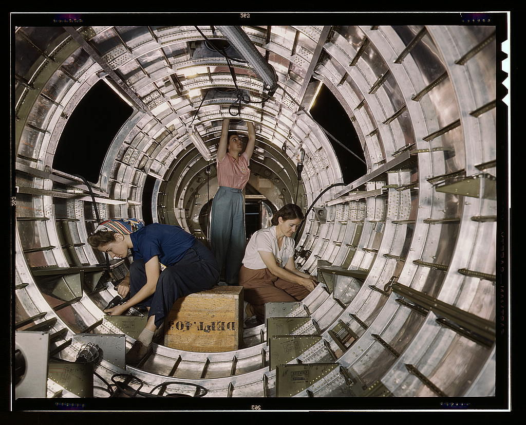 "Flickr Photo Download: Women workers install fixtures and assemblies to a tail fuselage section of a B-17F bomber at the Douglas Aircraft Company, Long Beach, Calif. Better known as the ""Flying Fortress,"" the B-17F is a later model of the B-17 which distinguished itself in acti"