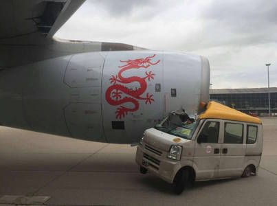 WATCH: Van crushed after driving straight into Dragonair plane's engine at Hong Kong airport: Shanghaiist