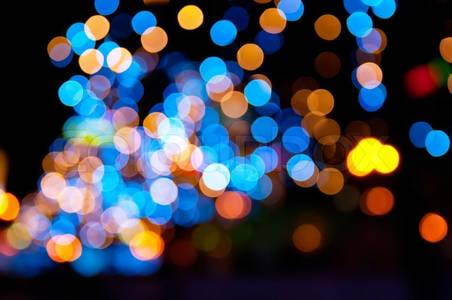 Stock image of 'Christmas shiny city bokeh in yellow and blue colors'